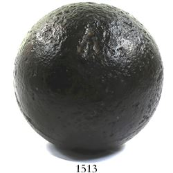 "Medium iron cannonball (""12-pounder"") from Fort Ticonderoga, New York, with British Naval broad arro"