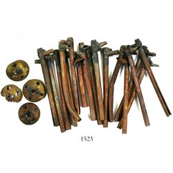 Lot of 17 copper cannon fuses and 4 copper firing caps, mid-1800s.
