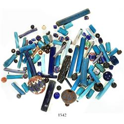 Lot of over 100 trade beads, mostly glass but one iron and some garnet, Spanish colonial (1500s).