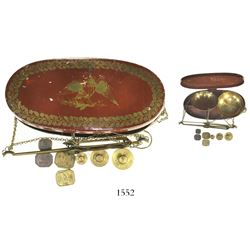 Gold miner's brass pan scales in original painted tin box, mid-1800s.