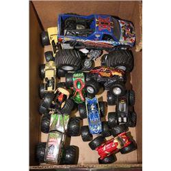 BOX OF DIE CAST MONSTER TRUCKS & SKATEBOARDS