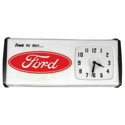 "Automotive clock, Ford ""Time to Buy?."", molded plastic light-up, VG working cond w/small crack in bl"