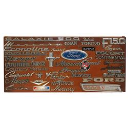 "Automotive emblem display board w/approx 35 Ford emblems, no duplicates, Exc cond, 15""H x 32""W."