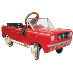 """Child's pedal car, Mustang GT, pressed steel 5 speed, c.1965, VG orig cond, 21""""H x 42""""L."""