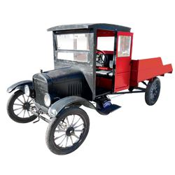 Truck, 1924 Ford Model T Flatbed.  Four cylinder. Black with red wood trim and bed rails.  Nice appe