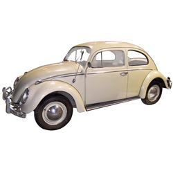 Automobile, 1960 Volkswagen 2-Door Coupe.  Very light pastel green with tan interior. Four-cylinder