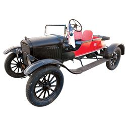 Automobile, 1923 Ford Model T Roadster. Black with red wooden boat-tail design. Four cylinder. Woode