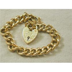 A 9ct Gold Curblink Bracelet With An Engraved Heart Locket And Safety Chain 38 4g Est 200 250
