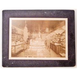 ANTIQUE MOUNTED PHOTO OF THE INSIDE OF A GENERAL STORE