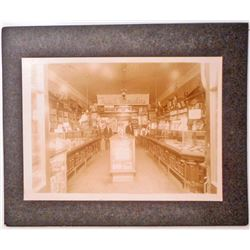 ANTIQUE MOUNTED PHOTO OF THE INSIDE OF A DRUG STORE