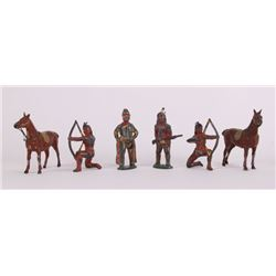 Six (6) vintage lead toy Indians and a cowboy figures.