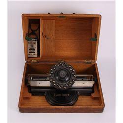 Antique Typewriter in original oak case manufactured by