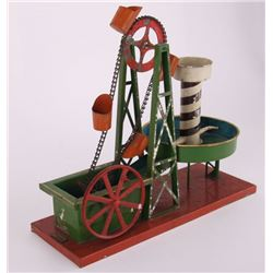 DRGM, German made tin toy, of a spinning water mill.