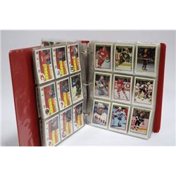 BINDER OF ASSORTED HOCKEY CARDS