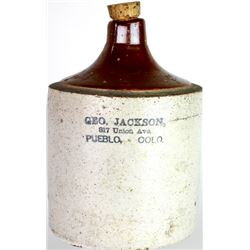 Advertising stoneware whiskey jug stamped