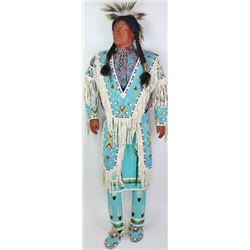 Life size figural Plains Indian in full regalia,