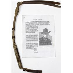 Good braided rawhide quirt with leather wrist