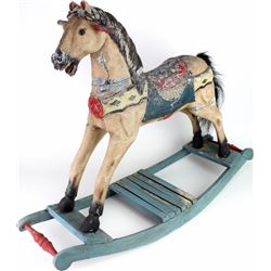 Childs wooden rocking with horse hair tail