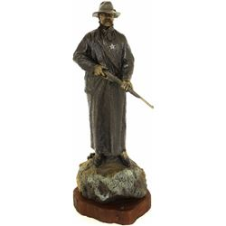"""Monsoon On the Mogollon"" bronze of Arizona"