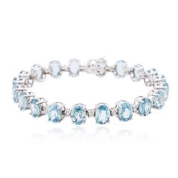 14KT White Gold 27.80 ctw Topaz and Diamond Bracelet