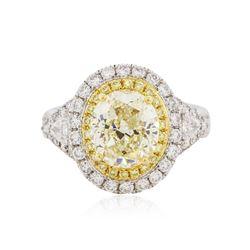 18KT White Gold 4.24 ctw Fancy Yellow Diamond Ring
