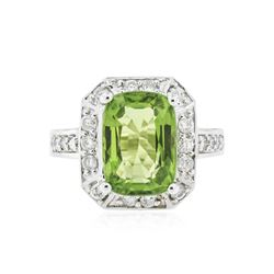 14KT White Gold 5.81 ctw Peridot and Diamond Ring