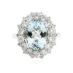 14KT White Gold 6.18 ctw Blue Topaz and Diamond Ring