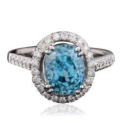 14KT White Gold 5.77 ctw Blue Zircon and Diamond Ring
