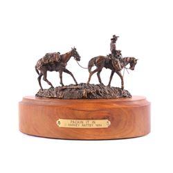 Packin It In Bronze by Harvey Rattey 1984