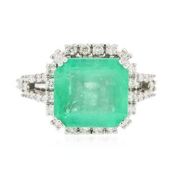 14KT White Gold 6.66 ctw Emerald and Diamond Ring