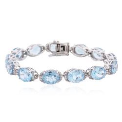 PLATED SILVER 44.94 ctw Blue and White Topaz Bracelet