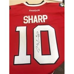 Autographed Patrick Sharp Chicago Blackhawk's Jersey with certificate of aunthentication. Donated by