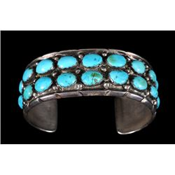 """Navajo Silver And Turquoise Bracelet Stamped ML Sterling 6"""" L. 1"""" W. 1 1/4"""" W. Gap  Good Condition"""