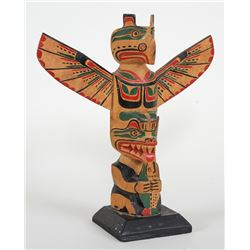 Northwest Coast Totem Carved with Thunderbird and Bear Holding a Salmon Attributed to Phillip or Geo
