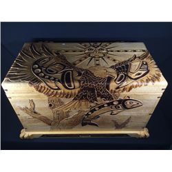 HEAVILY CARVED CEDAR BOX BLANKET BOX, DEPICTING EAGLE, SUN AND SALMON AND FROG HINGES.