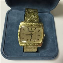ONE 14KT YELLOW GOLD LADIES OR GENTS MAPPIN'S VINTAGE DRESS WATCH, CIRCA 1970. ATTACHED IS A 14KT