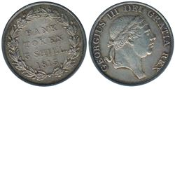 Great Britain; 1813 Bank of England 3 Shilling in AU-UNC condition. A lustrous coin with soft tones