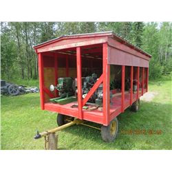 Four wheel trailer w/ deck one wall and roof