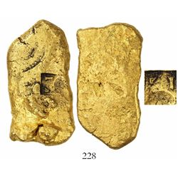 Gold  oro corriente  cut piece with tax stamps and partial letter-stamp, 82.57 grams, from an uniden