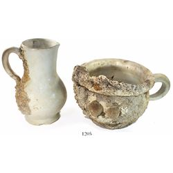 Intact porcelain toilet set: chamber pot and pitcher, partially encrusted.