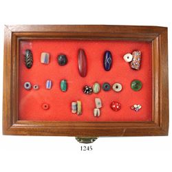 Collection of 26 colonial glass beads, 1500s-1700s.