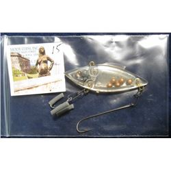15. Clear Plastic Weighted Shad Lure. BBs and Lead shot inside. Treble hook with a trailer. No box.