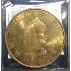 672. May 1971 Pella Tulip Time Brass Dollar. 39 mm. BU. Depicts Queen Tricia. Pella, Iowa.
