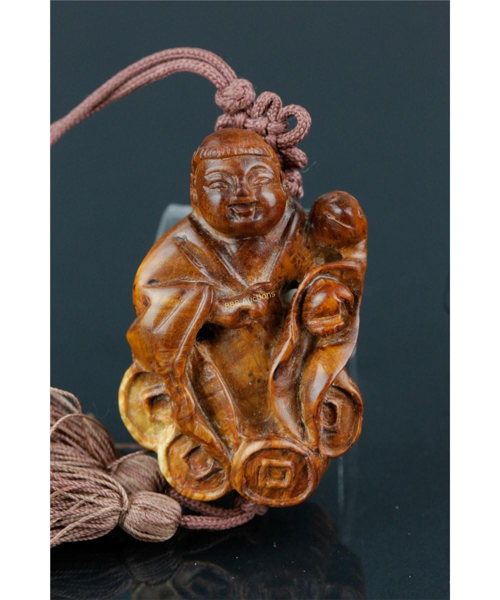 A japanese boxwood carving of a shishi and cub hessink s