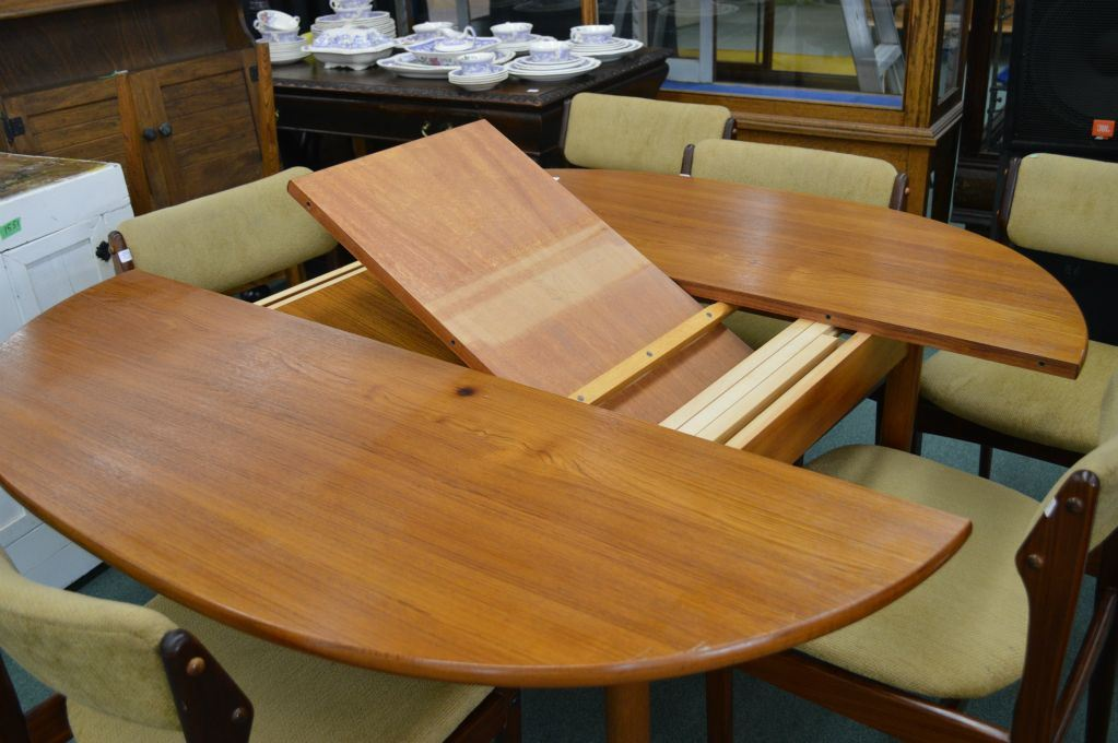 A Mid Century Modern Teak Dining Table With Hidden Leaf Storage Note