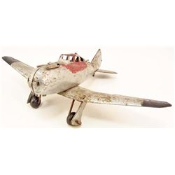 C. 1940S PRESSED STEEL FIGHTER AIRPLANE