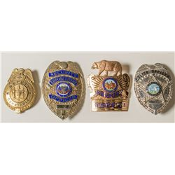 Four Law Enforcement Badges