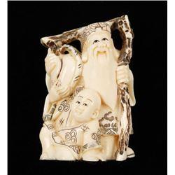 Ivory Netsuke of Bearded Man and Momotaro