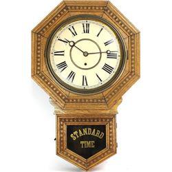 Antique oak cased school wall clock by