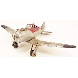 C. 1940S PRESSED STEEL FIGHTER AIRPLANE